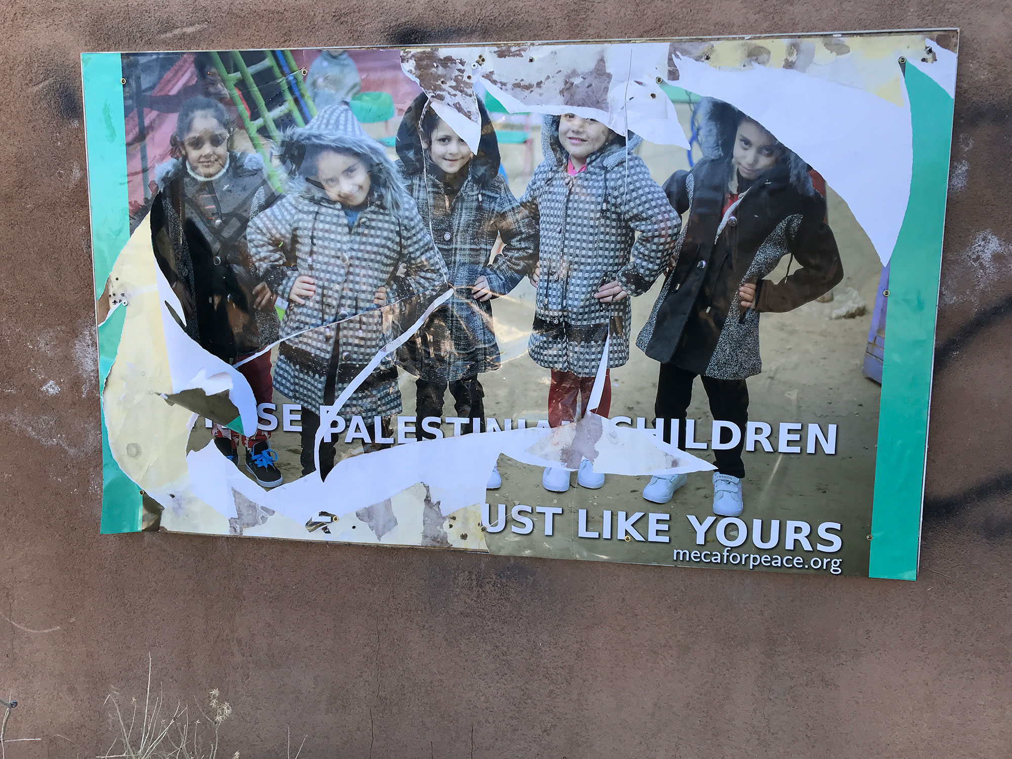 This photo of Palestinian children was torn apart within 72 hours of display.