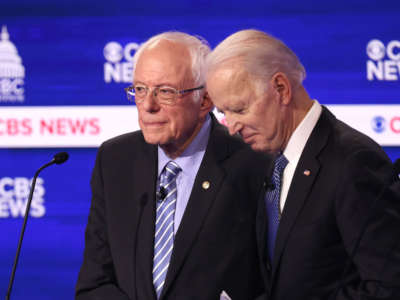 Sen. Bernie Sanders and former Vice President Joe Biden speak during a break at the Democratic presidential primary debate at the Charleston Gaillard Center on February 25, 2020, in Charleston, South Carolina.