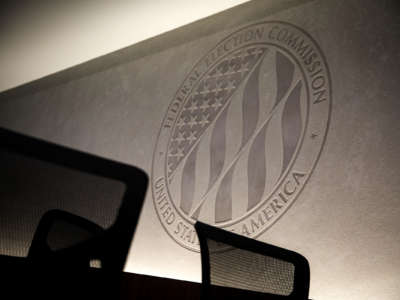 The seal of the Federal Election Commission is engraved into a stone wall inside its headquarters