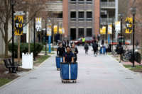Towson University students remove their belongings from the dorms as the school shuts down days before the start of the scheduled spring break on March 11, 2020, in Towson, Maryland.