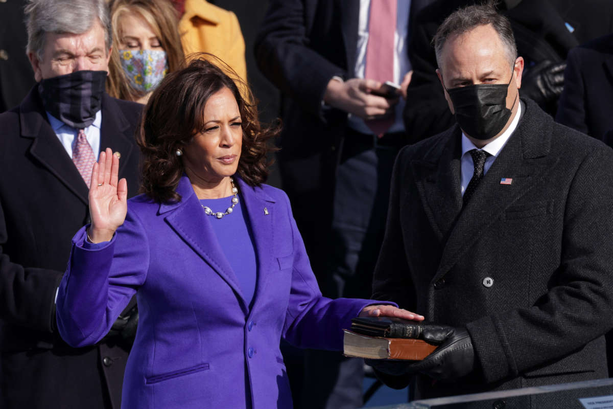 Kamala Harris is sworn as Vice President by Supreme Court Associate Justice Sonia Sotomayor as her husband Doug Emhoff looks on at the inauguration of President-elect Joe Biden on the West Front of the U.S. Capitol on January 20, 2021, in Washington, D.C.