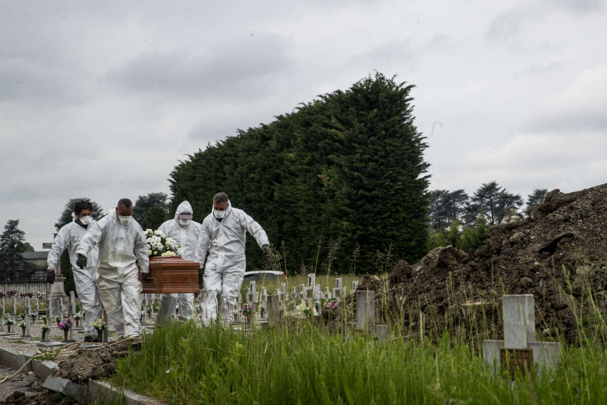 A funeral procession, with only cemetery workers with protective clothes, of a Covid-19 suspect nun who died in a hospital.