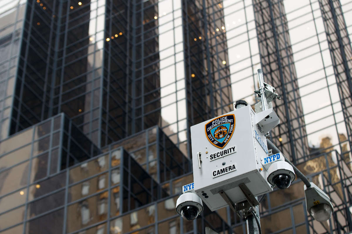 A New York City Police Department security camera hangs atop a light pole across the street from Trump Tower, March 7, 2017, in New York City.