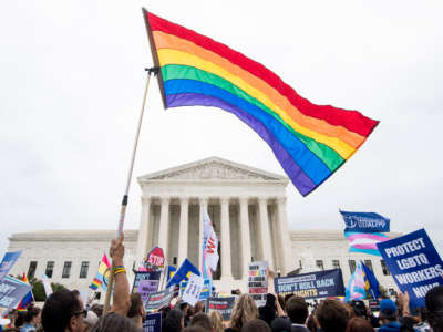 Protesters rally in front of the Supreme Court as it hears arguments on whether gay and transgender people are covered by a federal law barring employment discrimination on the basis of sex on October 8, 2019.