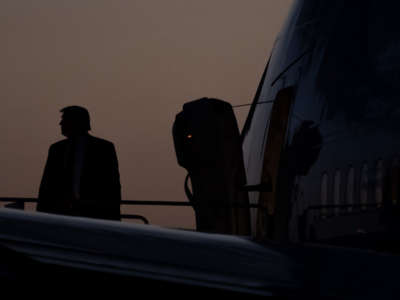 Donald Trump boards Air Force One in ominously stormy conditions