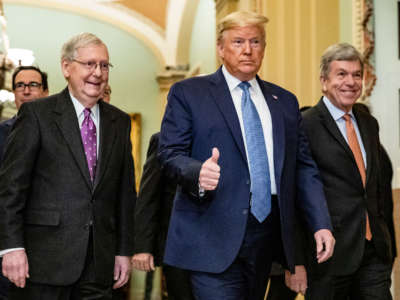 President Trump arrives at the U.S. Capitol to attend the Republicans weekly policy luncheon on March 10, 2020, in Washington, D.C. He is flanked by Senate Majority Leader Mitch McConnell and Republican Policy Committee Chairman Senator Roy Blunt.