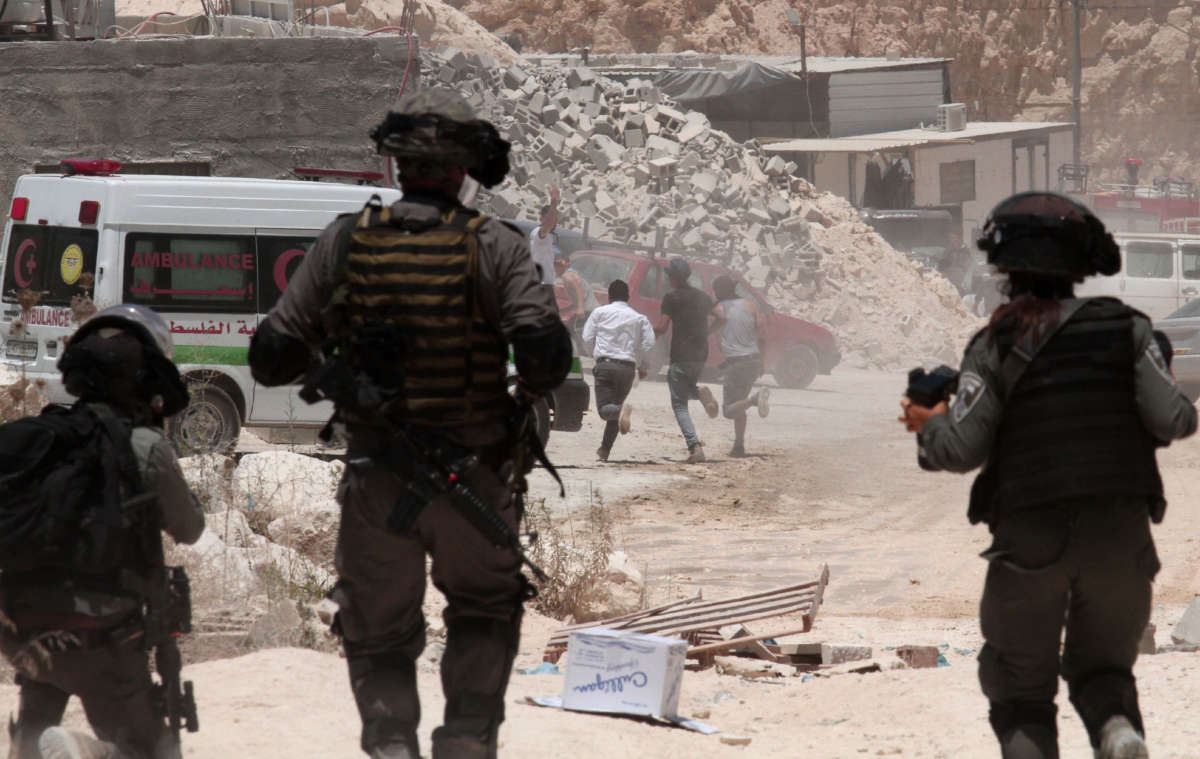 Israeli security forces intervene with Palestinian demonstrators after they staged a counter protest against the Jewish settlers camping on a hill in the town of Beita, near Nablus, West Bank, on July 18, 2020.