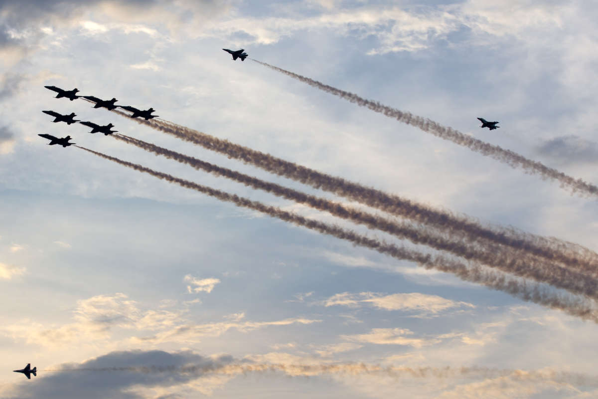 """U.S. Navy Blue Angels and U.S. Air Force Thunderbirds fly over the Washington Monument at the National Mall during the 2020 """"Salute to America"""" event on Independence Day in Washington, D.C., July 4, 2020."""