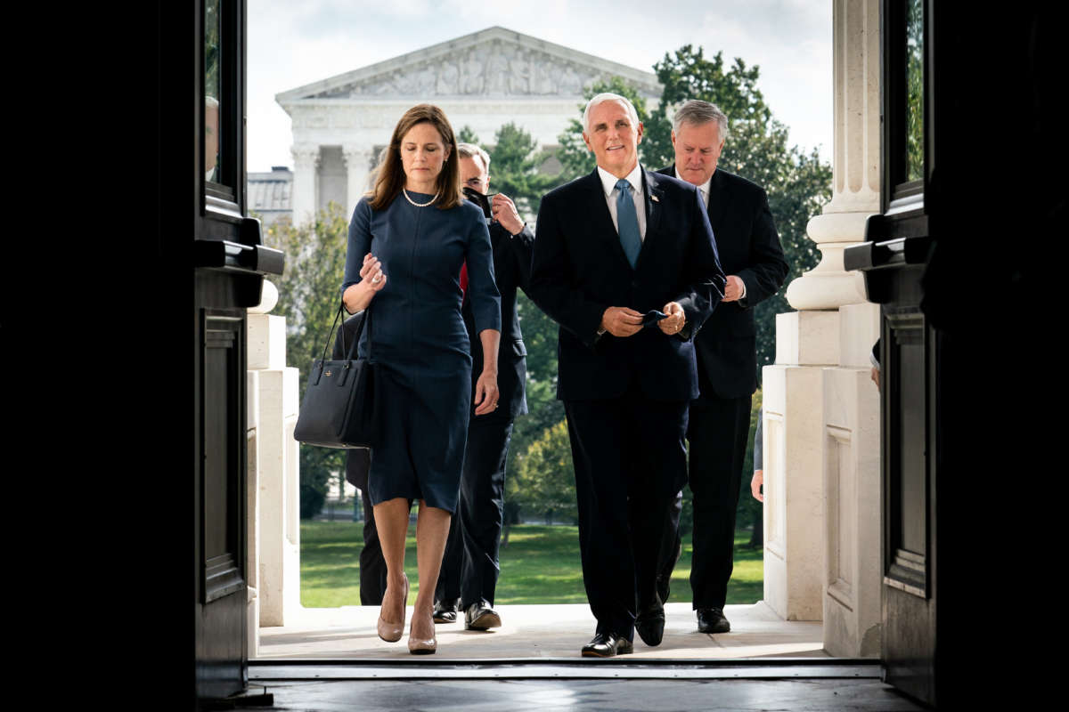 Seventh U.S. Circuit Court Judge Amy Coney Barrett, President Donald Trump's nominee for the U.S. Supreme Court, and Vice President Mike Pence arrive at the U.S. Capitol on September 29, 2020, in Washington, D.C.