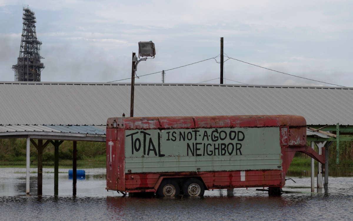 A protest sign is seen on a truck in flood water, from Hurricane Laura, by a Total oil refining plant near Port Arthur, Texas, on August 28, 2020.