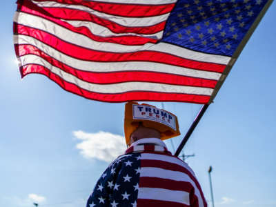 A supporter of President Trump waves a U.S. flag at a rally in West Salem, Wisconsin, on October 27, 2020.