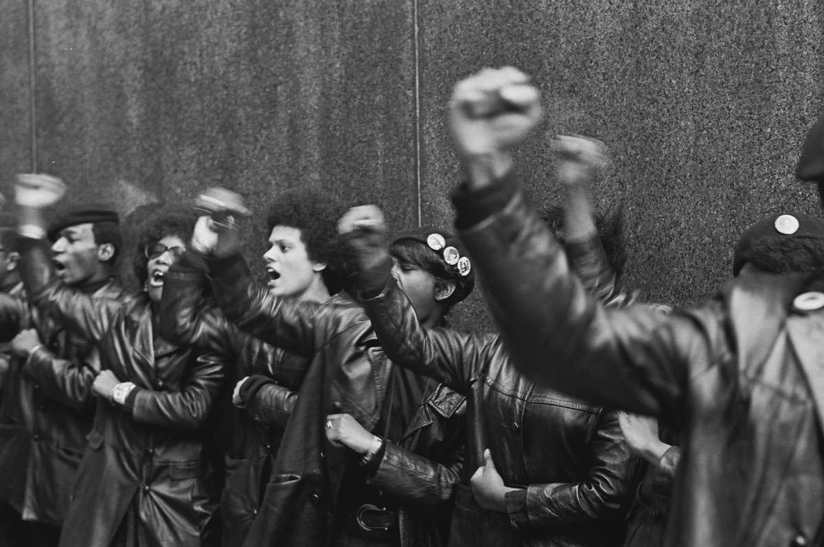 Black Panther Party members demonstrate, fists raised outside the New York City courthouse, New York, New York, on April 11, 1969.