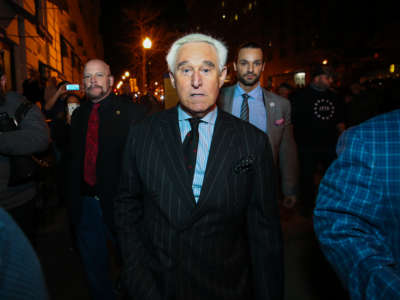 American political consultant Roger Stone walks through the crowd by his hotel as Trump supporters and Proud Boys held rally at night in Washington, D.C., United States on December 11, 2020.