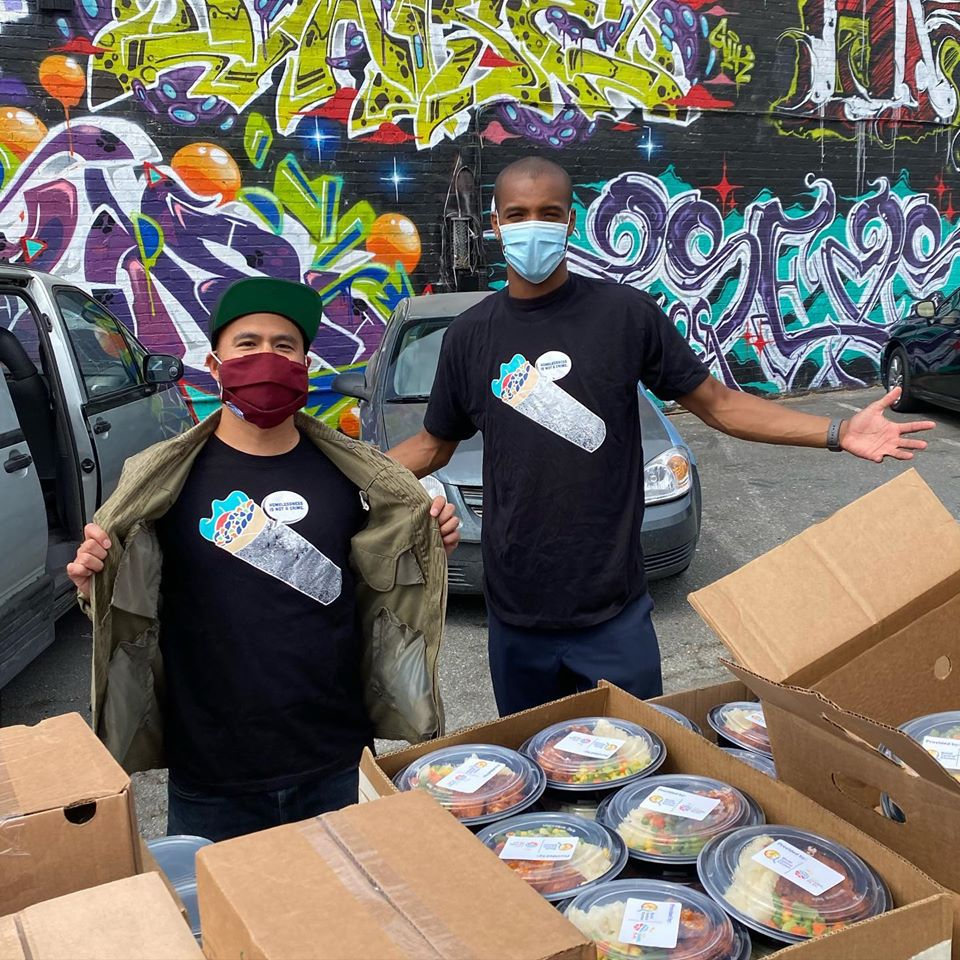 Mikey Disko and Malcolm Jefferson spread mutual aid love and get pumped to load up volunteers with hot meals, provided by World Central Kitchen, for socially distant distributions to unhoused folks in Oakland, California.