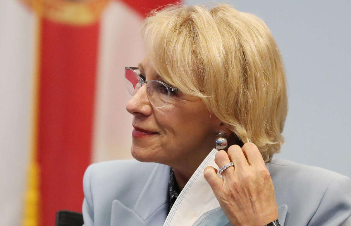Secretary of Education Betsy DeVos dons a mask during a visit to Florida Virtual School in Orlando, Florida, on October 26, 2020.