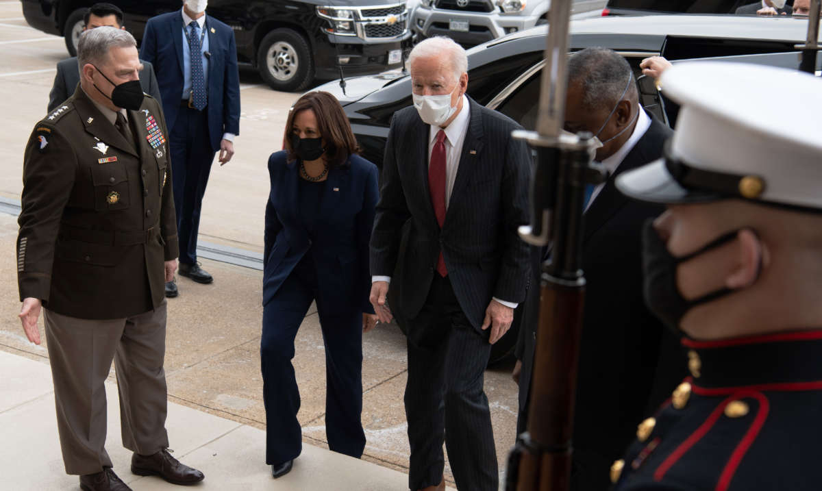 President Joe Biden walks alongside Vice President Kamala Harris, Chairman of the Joint Chiefs Mark Miller and Secretary of Defense Lloyd Austin as he arrives at the Pentagon in Washington, D.C., on February 10, 2021.
