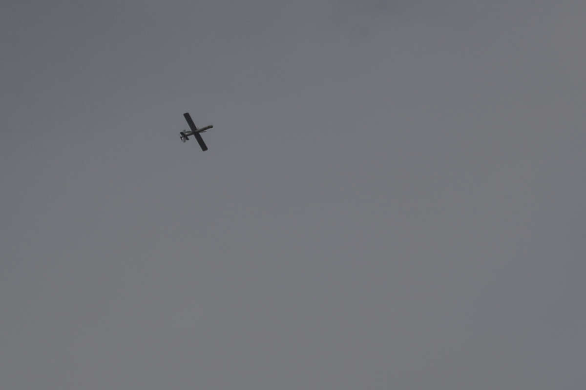 A military drone is seen flying over the Syrian village of Nahleh on October 31, 2020.