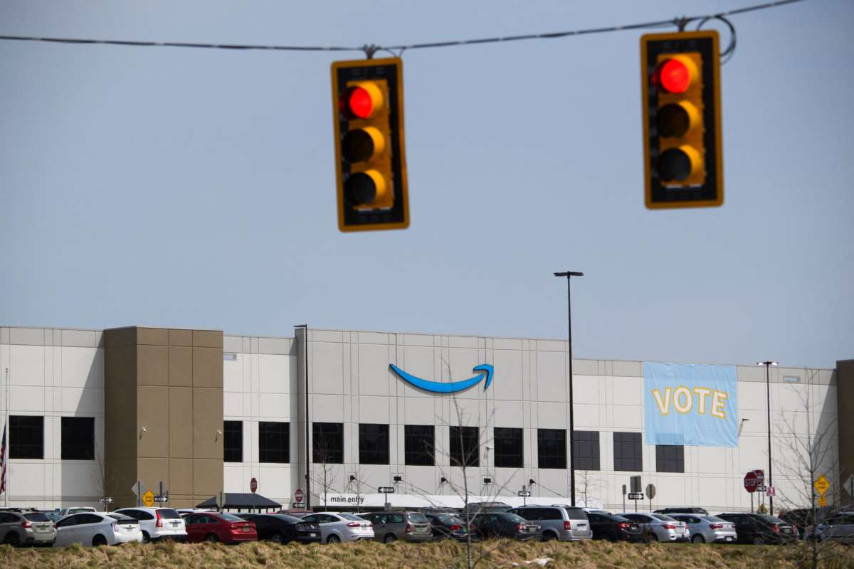Traffic lights at an intersection outside the Amazon.com, Inc. fulfillment center in Bessemer, Alabama, on March 26, 2021.