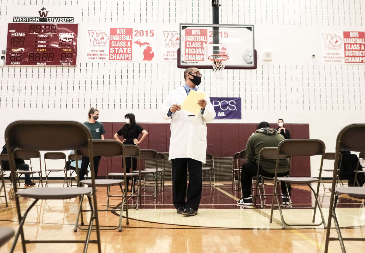 Medical staff watch and advise walk-in patients who received their COVID-19 vaccination at a pop-up clinic at Western International High School on April 12, 2021, in Detroit, Michigan.
