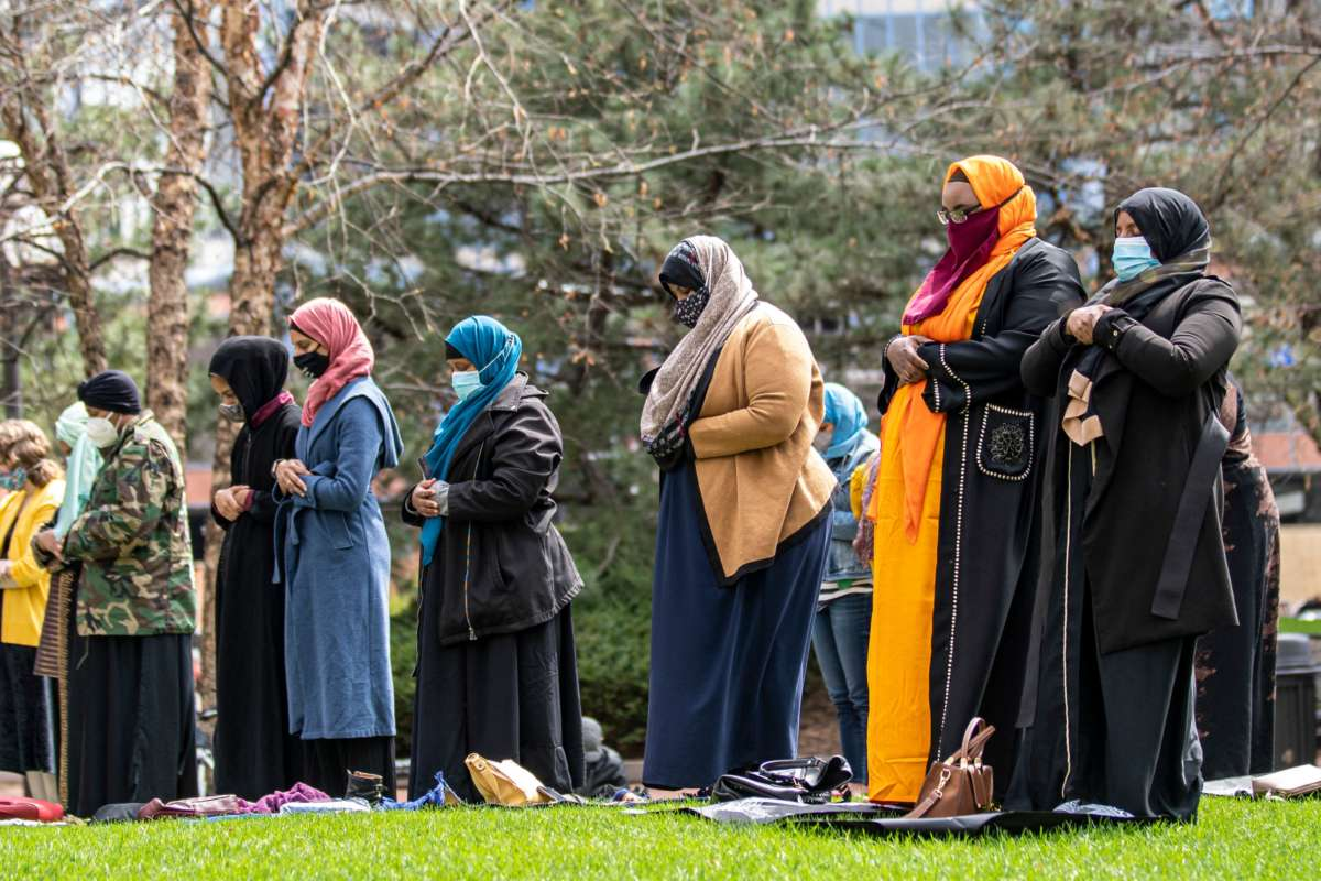 People attend the first Friday prayers of the Islamic holy month of Ramadan outside the Hennepin County Government Center in Minneapolis, Minnesota on April 16, 2021. Makram El-Amin called for justice for those that were lost to police violence in the Friday sermon.