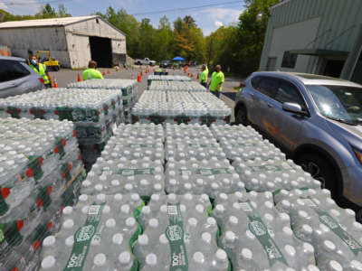 The city of Wayland, Massachusetts, distributes bottled water to the public due to elevated levels of PFAS found in its public water sources on May 16, 2021.