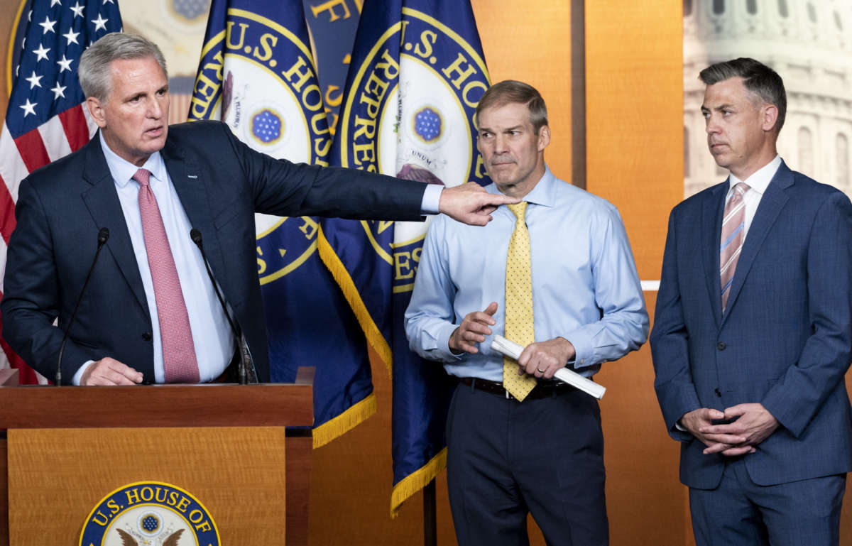 House Minority Leader Kevin McCarthy (R-California), left, speaks as Representatives Jim Jordan (R-Ohio) and Jim Banks (R-Indiana), listen during McCarthy's news conference on Wednesday, July 21, 2021.