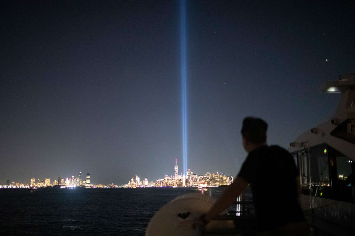A man looks at the twin towers installation marking the former location of the world trade center buildings
