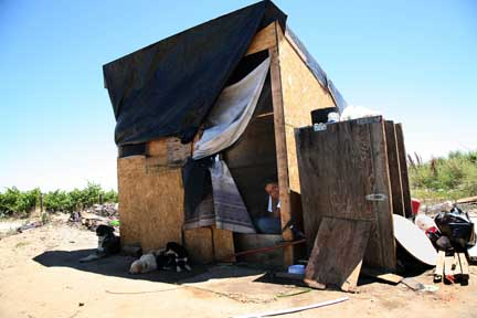 A shack built by immigrant workers on a rancher's land.