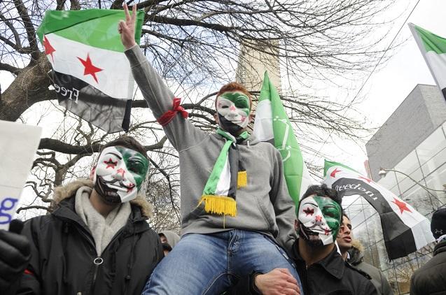 Young unidentified Syrians chanting slogans during a protest rally organized to raise awareness and commemorate two years of Syrian revolution on March 16, 2013 in Toronto, Canada. (Photo: <a href=