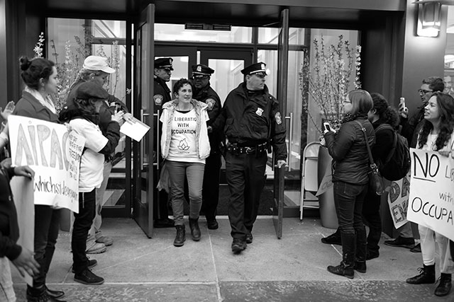 IfNotNow member is arrested for chaining herself to table inside AIPAC lobby. (Photo: Sam Boaz)