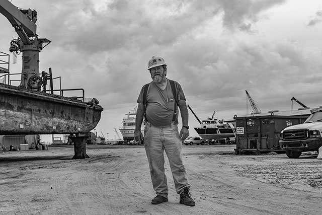 A shipyard worker laments about the lagging economy in Venice. (Photo: Michael Stein)
