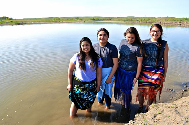 Rezpect Our Water campaign youth leaders (left to right) Tokata Iron Eyes, AnnaLee Yellow Hammer, Precious Winter Roze Bernie, and Winona Gayton stand in defense of land and water. (Photo: Kettie Jean)