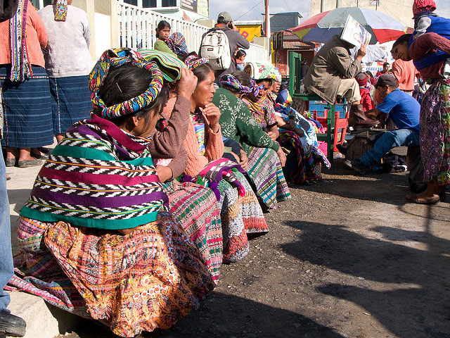 Guatemalan women sit in a line to wait for a referendum vote against proposed mining in San Juan Ostuncalco, Guatemala, on February 18, 2011. (Photo: Capt Acab)