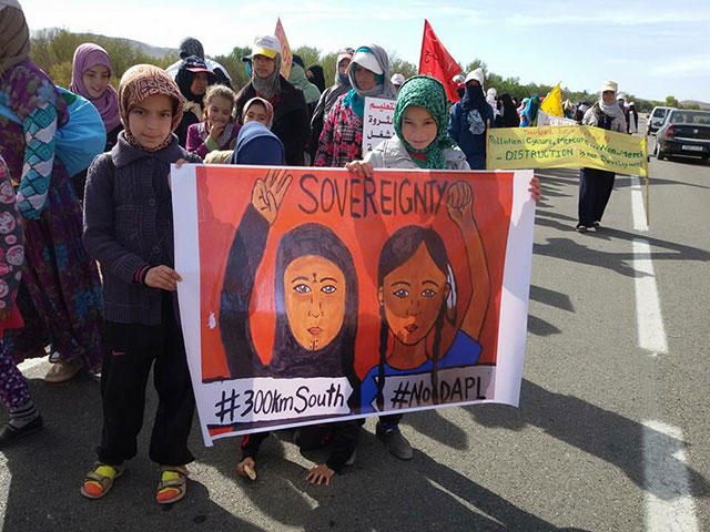 With a banner depicting their fight against the silver mining corporation Managem as a sister struggle to the fight against the Dakota Access pipeline in Standing Rock, Indigenous Amazigh people from the Moroccan town of Imider continued their protest against the mining corporation on November 20, 2016. (Photo: Nadir Bouhmouch)
