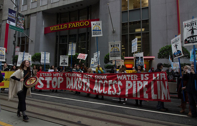 Led by the women of Idle No More Bay Area, banks were visited in San Francisco's Financial District and accounts were closed at Wells Fargo, Citibank and Chase — all major funders of the Dakota Access Pipeline — on November 30, 2016.