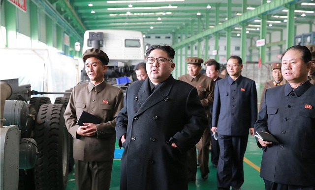 This undated picture released from North Korea's official Korean Central News Agency (KCNA) on November 4, 2017 shows North Korean leader Kim Jong-Un (C) visiting the March 16 factory at an undisclosed place. (Photo: STR/AFP/Getty Images)