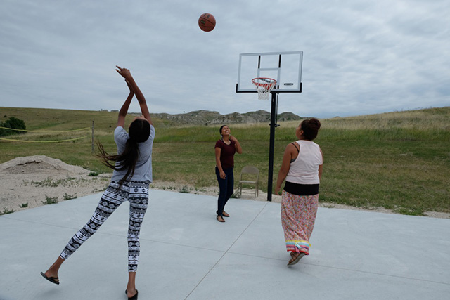 Lakota girls from Pine Ridge play basketball at the first private girls school on the reservation, called Anpo Wicahpi (