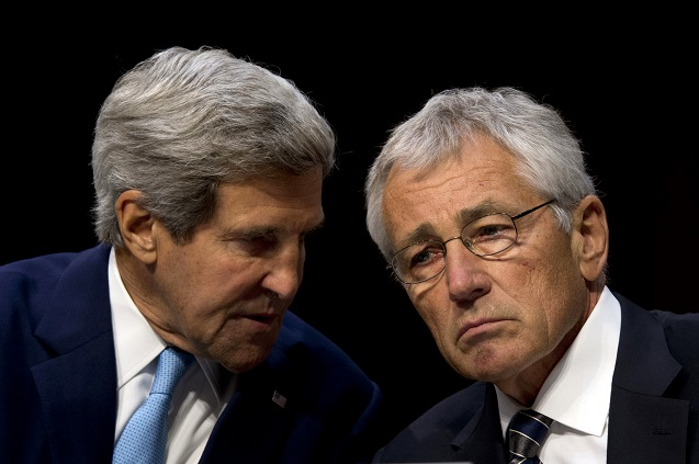 Secretary of State John Kerry confers with Secretary of Defense Chuck Hagel during testimony on US military intervention in Syria before the Senate Foreign Relations Committee at the Senate Hart Office Building in Washington, DC, on September 3, 2013. (Photo: <a href=