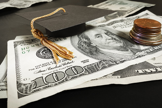 (Image: mortar board on cash via Shutterstock)