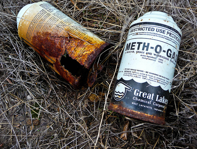 Discarded and corroded cans of methyl bromide found on a wildlife preserve. (Photo: Michael McCullough)