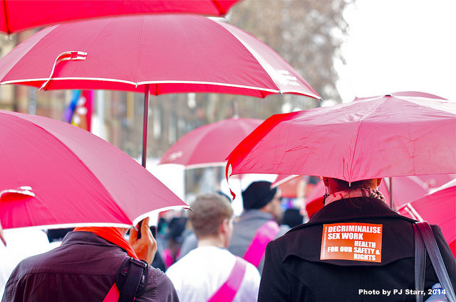 Participants march with red umbrellas during the AIDS 2014 Mobilization March in Melbourne, Australia, on July 22, 2014. (Photo: PJ Starr)