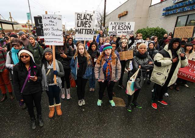 6 December, 2014: Demonstrators in Seattle, Washington march in support of Eric Garner and Michael Brown, two unarmed men killed by police officers. (Photo: Scottlum)