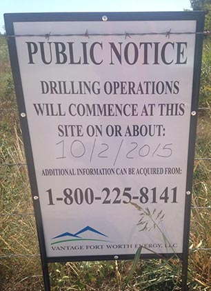 Try calling the number listed on this sign provided by Vantage Energy as public notice for residents living adjacent to three gas wells undergoing fracking. You will be offered a free cruise. (Photo: Elida Tamez)