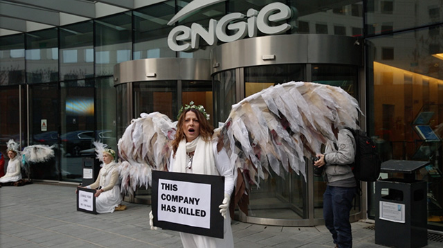 Sam Castro with Climate Guardian Angels blocks the entryway to Engie's headquarters in La Défense, Courbevoie, December 10, 2015. Castro is from Australia, where she said Engie is responsible for a mine fire in Victoria that burned for 45 days and killed 11 people. (Photo: Garrett Graham)