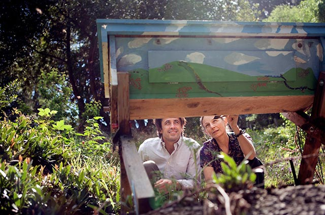 Dr. Kegley shows attorney Greg Loarie a bee box in the backyard of her home in California. (Photo: Chris Jordan-Bloch / Earthjustice)