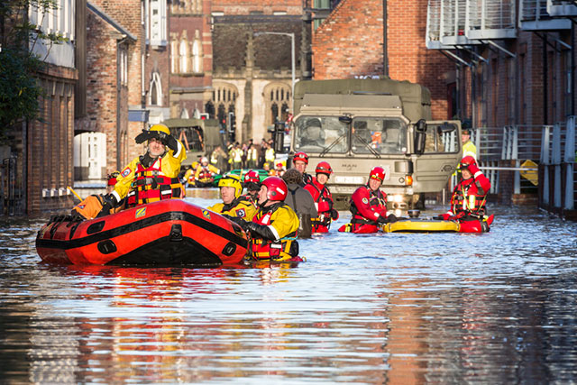 Flood rescue by the British Army and the Mountain Rescue navigate a flooded street in York City Centre after heavy rain, on December 27, 2015. (Photo via Shutterstock)