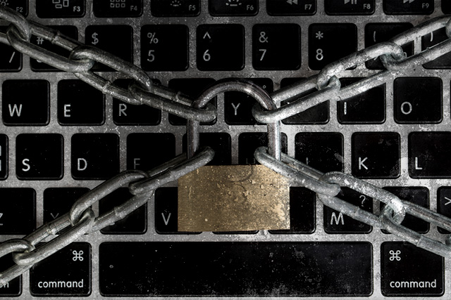 (Photo: Keyboard in Chains via Shutterstock; Edited: LW / TO)