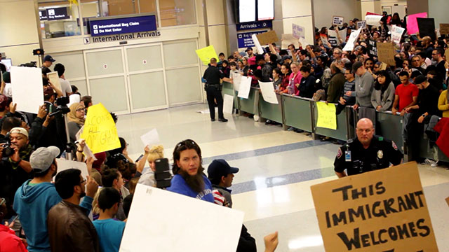 Hundreds of protesters gathered in Dallas-Fort Worth airport's terminal D for international arrivals Saturday, January 28, to protest President Trump's executive order barring foreign travelers and refugees from entering the country and to pressure Customs and Border Patrol agents to release nine people who were detained there Saturday night. Similar protests erupted at major international airports across the country throughout the weekend. (Photo: Garrett Graham)