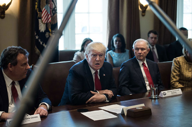 President Donald Trump, flanked by New Jersey Governor Chris Christie (L) and Attorney General Jeff Sessions (R), speaks during a meeting in the Cabinet Room at the White House in Washington, DC, on March 29, 2017. (Photo: Nicholas Kamm / AFP / Getty Images)
